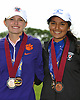 Lindsay May of Auburn, left, and Malini Rudra of Syosset pose for pictures after the NYSPHSAA girls golf state championship at Bethpage State Park's Yellow Course on Sunday, June 3, 2018.