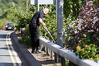 Pictured: Police officers search by the A4049 road near the house where the body of David Gaut was discovered in New Tredegar, Wales, UK. Wednesday 08 August 2018<br /> Re: Three men have been arrested after a man was found dead at a house in New Tredegar, Wales, UK.<br /> David Gaut, 54, was found in Long Row, in the Elliots Town area of New Tredegar, on Saturday, August 4.<br /> Two two-storey terraced homes, owned by Caerphilly council, have been cordoned off and police officers are patrolling the area. <br /> David Gaut was jailed for life in July 1985 when he was 21 years old, for the murder and torture of17-month old Chi Ming Shek