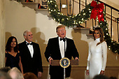 United States President Donald J. Trump makes remarks as First lady Melania Trump, US Vice President Mike Pence, and Karen Pence look on at the Congressional Ball at White House in Washington, DC on December 15, 2018. <br /> Credit: Yuri Gripas / Pool via CNP