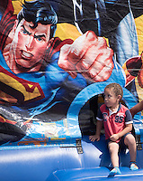 NWA Democrat-Gazette/J.T. WAMPLER  Dontez Holman, 2, slips out of an inflatable house Sunday Aug. 16, 2015 at the Family Fun Fest at St James Missionary Baptist Church in Fayetteville. The church held the festival to celebrate it's 150th anniversary.