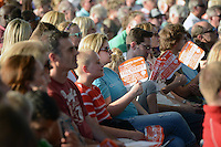 NWA MEDIA SAMANTHA BAKER @NWASAMANTHA<br /> Worshipers try to keep cool with fans during a Cross Church event Sunday, Aug. 10, 2014, at the Walmart AMP in Rogers.