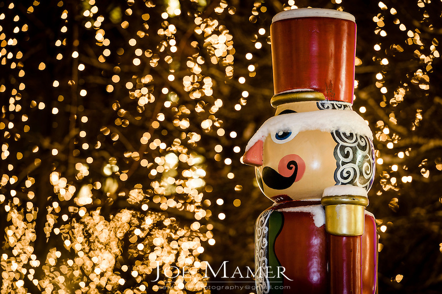 A statue of a nut cracker soldier welcomes the holiday season in Rice Park. The lighted trees and decorations are a holiday tradition in downtown St. Paul, Minnesota.