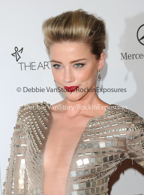 """Amber Heard attends the Art of Elysium 4th Annual Charity Gala """"Heaven"""" held at The Annenberg Building at The California Science Center in Los Angeles, California on January 15,2011                                                                               © 2010 DVS / Hollywood Press Agency"""
