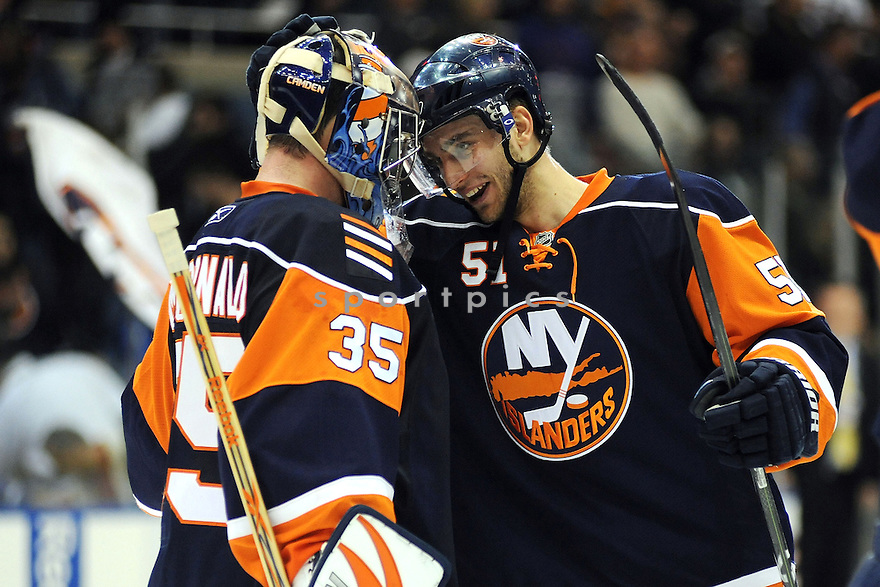Feb 16, 2009; Uniondale, NY, USA; New York Islanders goaltender Joey MacDonald (35) is greeted by teammate Frans Nielsen (51) after winning overtime shootout against Pittsburgh Penquins at the Nassau Coliseum. Islanders won in overtime shootout 3-2. Mandatory Credit: Tomasso DeRosa-SportPics