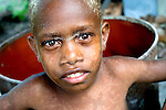 Young child in an isolated island village in the Solomon Islands. <br /> <br /> The Solomon Islands Red Cross has distributed mosquito nets across the country to keep villagers safe from malaria and conducts regular trainings on hygiene and first aid. Since many people can't get to a doctor or hospital, these measures are vital for keeping people healthy.