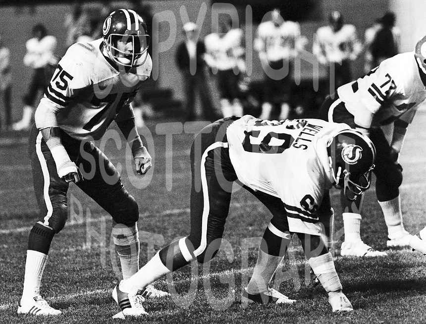 Bill Manchuk(75) and George Wells Saskatchewan Roughriders 1976. Copyright photograph Scott Grant