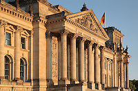 Reichstag building, opened 1894, seat of the German parliament and meeting place of the Bundestag, refurbished by Norman Foster 1990-99, including the addition of the huge glass dome, Berlin, Germany. Below the pediment reads the slogan 'Dem Deutsche Volk' or To The German People. The building sits on the river Spree. Picture by Manuel Cohen