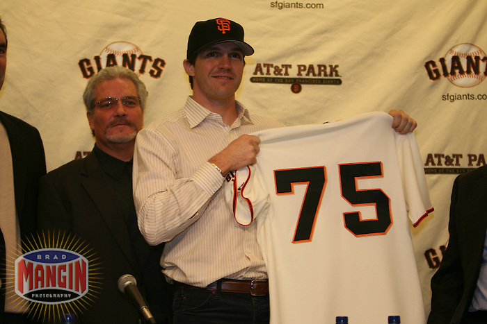 Barry Zito and Brian Sabean. Baseball: San Francisco Giants pitcher Barry Zito is introduced to the media at AT&T Park in San Francisco, CA on January 3, 2006. Photo by Brad Mangin