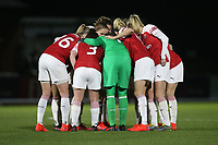 Arsenal players huddle during Arsenal Women vs Manchester United Women, FA WSL Continental Tyres Cup Football at Meadow Park on 7th February 2019