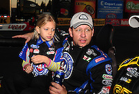 Feb. 27, 2011; Pomona, CA, USA; NHRA funny car driver Robert Hight holds daughter Autumn Hight after winning the Winternationals at Auto Club Raceway at Pomona. Mandatory Credit: Mark J. Rebilas-.
