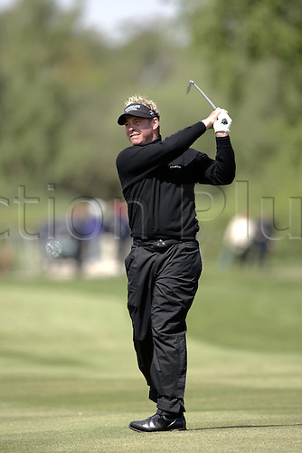 13 May 2005: Northern Irish golfer Darren Clarke looks into the distance after playing an iron from the fairway during the second round of the The Daily Telegraph Dunlop Masters played at the Forest of Arden, Warwickshire. Photo: Neil Tingle/Actionplus..050513 golf golfer player fairway