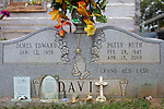 James Davis' wife Patsy was buried in the front yard of his Stevenson, Alabama home in April of 2009. The city wants the grave relocated. Mr. Davis is seen on his property in Stevenson October 15, 2013.