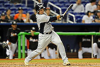 7 March 2012:  FIU catcher Iosmel Leon (13) bats as the Miami Marlins defeated the FIU Golden Panthers, 5-1, at Marlins Park in Miami, Florida.