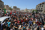 Mourners participate in the funeral of 14-year-old Palestinian boy Yasser Abu Al-Naja, who was killed by Israeli troops during clashes in tents protest where Palestinian demand the right to return to their homeland at the Israel-Gaza border, in Khan Younis, in the southern Gaza Strip June 30, 2018. Photo by Ashraf Amra