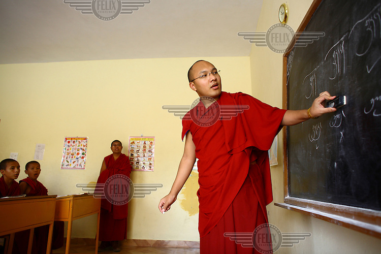 The Seventeenth Karmapa, Ogyen Drodul Trinley Dorje, teaches young monks at the Gyuto Tantric Monastic University, Dharamsala. In 1992 a 7-year-old Tibetan nomad, Apo Gaga, was recognised as the Seventeenth Karmapa and went to live in Tolung Tsurphu Monastery, the historic seat of the Karmapas. He escaped Tibet for India at the turn of the millennium in order to continue without interference the primary role of the Karmapa, preserving and propagating the Buddhist teachings of Tibet.