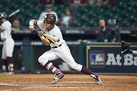 Jake Mangum (15) of the Mississippi State Bulldogs runs up to bunt during the game against the Houston Cougars in game six of the 2018 Shriners Hospitals for Children College Classic at Minute Maid Park on March 3, 2018 in Houston, Texas. The Bulldogs defeated the Cougars 3-2 in 12 innings. (Brian Westerholt/Four Seam Images)