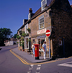 A3AAG1 Antique shop and red pillar box Sherborne Dorset England
