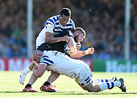 Alec Hepburn of Exeter Chiefs is double-tackled by Anthony Perenise and Tom Dunn of Bath Rugby. Gallagher Premiership match, between Exeter Chiefs and Bath Rugby on March 24, 2019 at Sandy Park in Exeter, England. Photo by: Patrick Khachfe / Onside Images