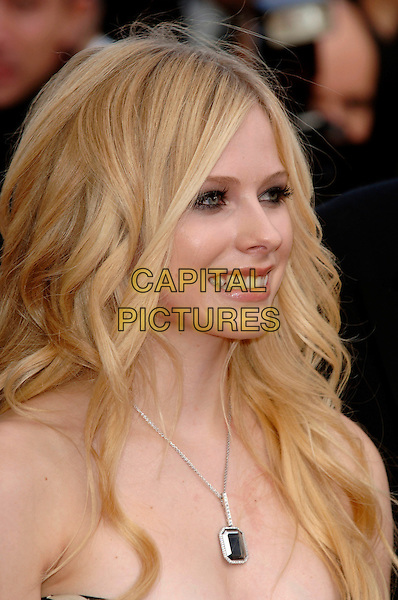 """AVRIL LAVIGNE.""""Over the Hedge"""" screening arrivals.59th International Cannes Film Festival, France.21st May 2006.Ref: PL.headshot portrait necklace.www.capitalpictures.com.sales@capitalpictures.com.©Phil Loftus/Capital Pictures"""