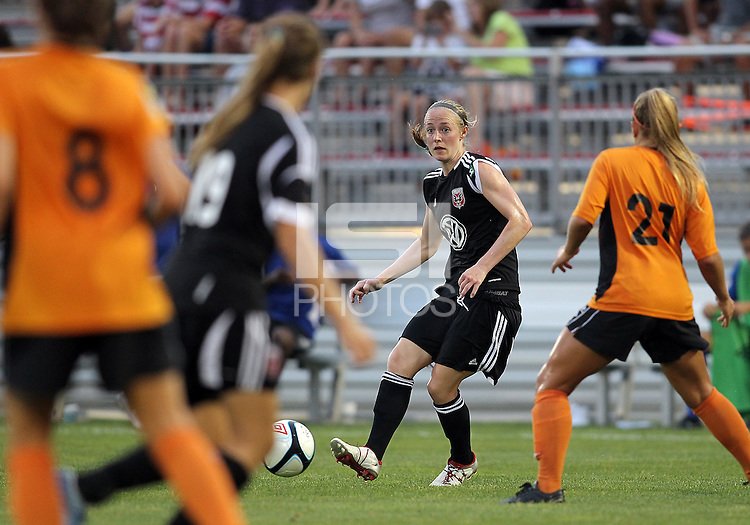 BOYDS, MARYLAND-JULY 07,2012:  US Olympian Becky Sauerbrunn (11) of DC United Women makes a pass against the Dayton Dutch Lions during a W League game at Maryland Soccerplex, in Boyds, Maryland. DC United women won 4-1.