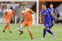 Houston, TX - Saturday June 17, 2017: Morgan Brian passes the ball in front of Camila Martins Pereira  during a regular season National Women's Soccer League (NWSL) match between the Houston Dash and the Orlando Pride at BBVA Compass Stadium.