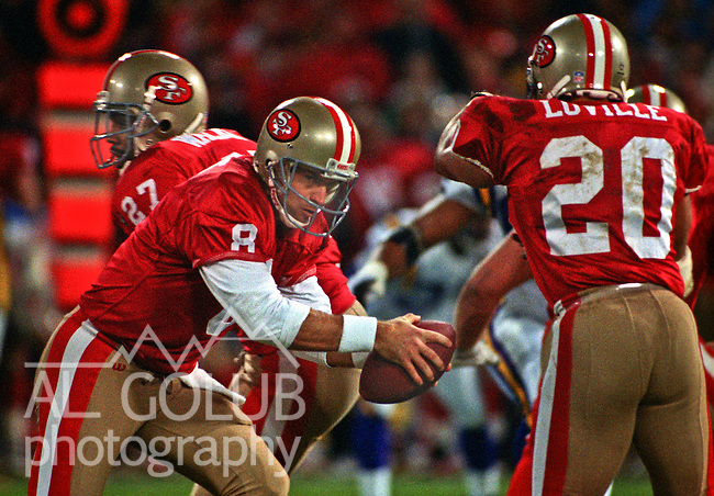 San Francisco 49ers vs. Minnesota Vikings at Candlestick Park Monday, December 18, 1995.  49ers beat Vikings  37-30.  San Francisco 49ers quarterback Steve Young (8) fakes hand off to running back Derek Loville (20).