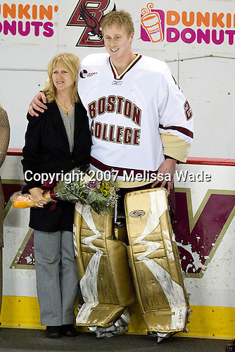 Arlene Pearce and Joe Pearce (Boston College - Brick, NJ) pose together during the pregame ceremony. The Boston College Eagles defeated the University of New Hampshire Wildcats 4-2 on BC's senior night, Saturday, March 3, 2007, at Kelley Rink at Silvio O. Conte Forum in Chestnut Hill, Massachusetts.