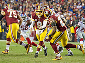 Washington Redskins quarterback Kirk Cousins (8) pitches the ball to running back Chris Thompson (25) during the fourth quarter against the New York Giants at FedEx Field in Landover, Maryland on Sunday, January 1, 2017.  Washington Redskins offensive guard Brandon Scherff (75) leads the blocking.  The Giants won the game 19 - 10.<br /> Credit: Ron Sachs / CNP<br /> (RESTRICTION: NO New York or New Jersey Newspapers or newspapers within a 75 mile radius of New York City)