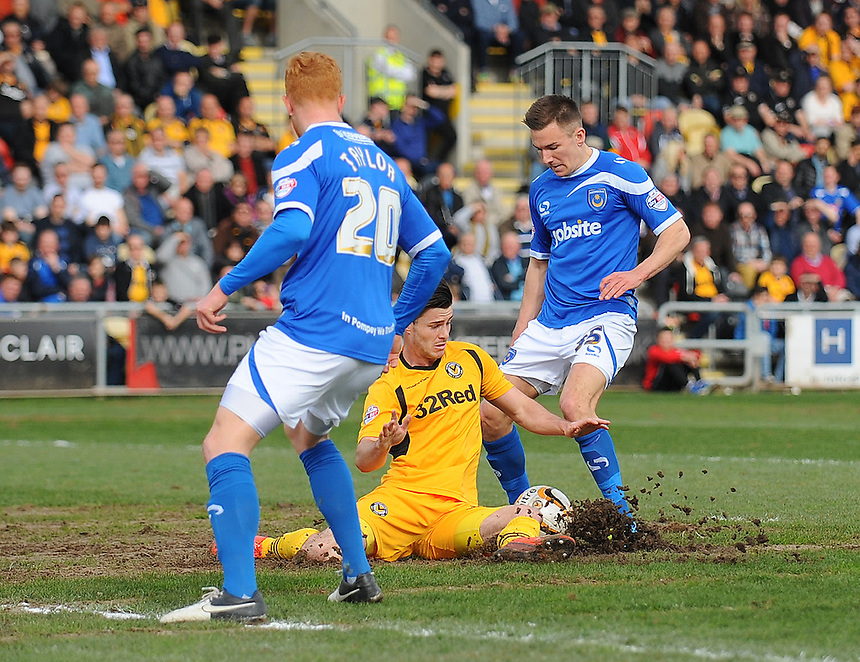 Portsmouth's Jed Wallace is tackled by Newport County's Andrew Hughes (partially obscured)<br /> <br /> Photo by Kevin Barnes/CameraSport<br /> <br /> Football - The Football League Sky Bet League Two - Newport County AFC v Portsmouth - Saturday 29th March 2014 - Rodney Parade - Newport<br /> <br /> &copy; CameraSport - 43 Linden Ave. Countesthorpe. Leicester. England. LE8 5PG - Tel: +44 (0) 116 277 4147 - admin@camerasport.com - www.camerasport.com