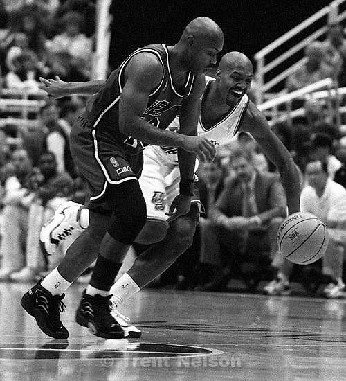 Utah's Bryon Russell (rear) attempts the steal from Miami's Tim Hardaway. Utah Jazz vs Miami Heat.   &amp;#xA;<br />