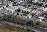 aerial photograph Caltrain emerges from tunnel San Francisco, California