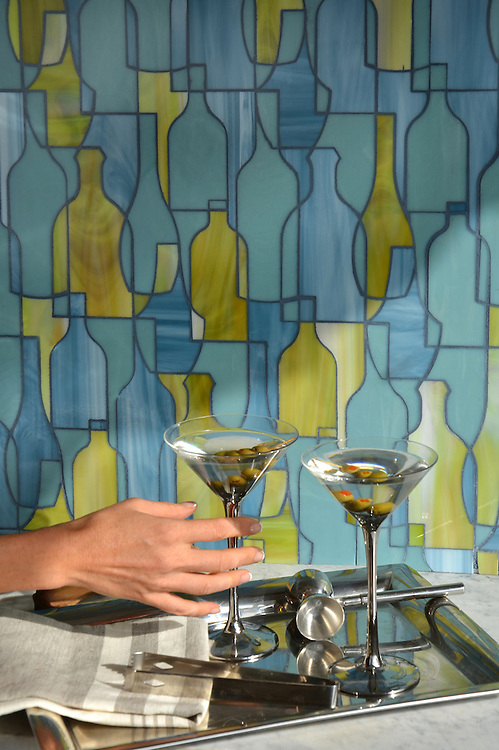 Bottles, a jewel glass mosaic in  Peridot, Serpentine, and Mica, is part of the Erin Adams Collection for New Ravenna.