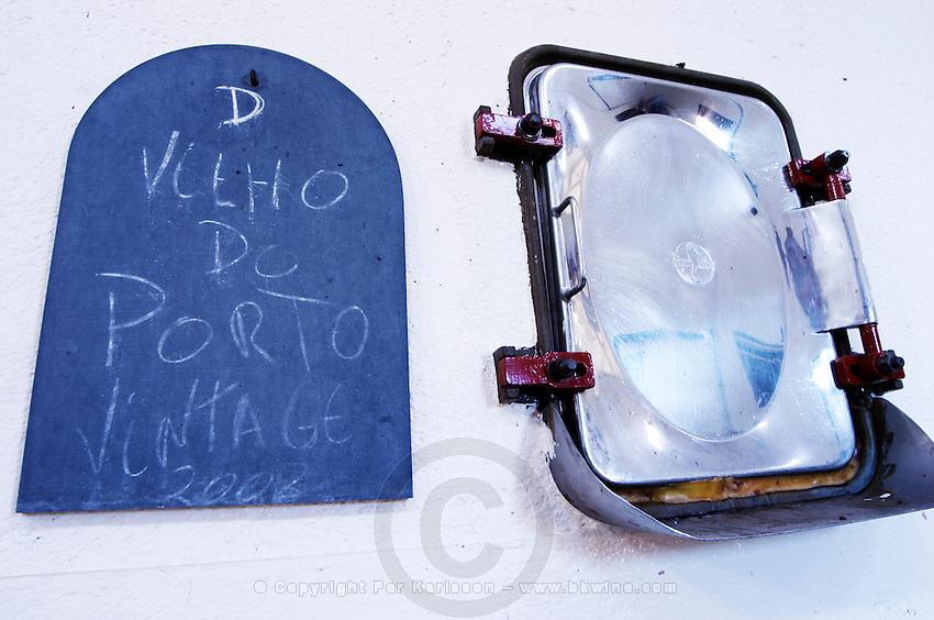 tank door sign on tank velho do porto vintage 2008 quinta do cotto douro portugal