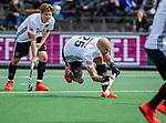 AMSTELVEEN  -  Justin Reid-Ross (Adam) met links Jan-Willem Buissant (Adam)  Hoofdklasse hockey dames ,competitie, heren, Amsterdam-Pinoke (3-2)  . COPYRIGHT KOEN SUYK