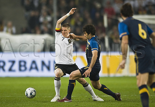 29 03 2011  Australia v Germany Freigdly. Bastian Schweinsteiger l ger in duel against Mile Jedinak Aus.