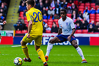 Fulham's midfielder Ryan Sessegnon (11) for England U21's  holds up FC Shakhtar Donetsk's midfielder Oleksandr Pikhalyonok (20) for Ukraine U21's during the International Euro U21 Qualification match between England U21 and Ukraine U21 at Bramall Lane, Sheffield, England on 27 March 2018. Photo by Stephen Buckley / PRiME Media Images.