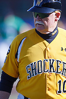 Coach Gene Stephenson during the NCAA matchup between the Wichita State Shockers and North Dakota Fighting Sioux at Eck Stadium on February 26th, 2012 in Wichita, Kansas.  The Shockers defeated UND 16-1.  (William Purnell/Four Seam Images)