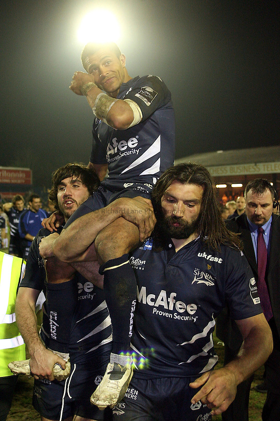 Photo: Paul Thomas..Sale Sharks v Bath Rugby. Guinness Premiership. 13/04/2007...Jason Robinson of Sale leaves the field for the last time at home on the shoulders of Sebastien Chabel (R) and Juan Fernandez Lobbe.