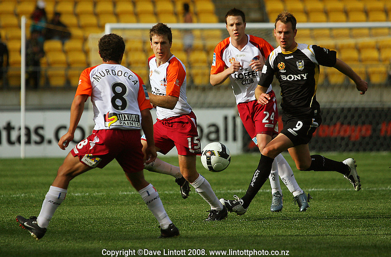 Shane Smeltz (right) chases the ball as Massimo Murdocca receives a pass during the A-League football match between the Wellington Phoenix and Queensland Roar at Westpac Stadium, Wellington. Sunday, 26 October 2008. Photo: Dave Lintott / lintottphoto.co.nz