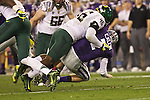 Oregon Ducks linebacker Michael Clay sacks Kansas State Wildcats quarterback Collin Klein in the first half of the Fiesta Bowl.