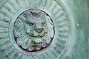 London, UK. 11.01.2015. Lion detail on mausoleum door, Highgate East Cemetery. Photograph © Jane Hobson.