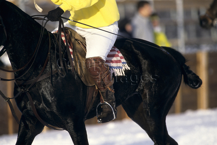 Snow polo player riding a horse