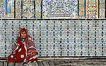 Berber woman at the courtyard of the Mosque of the Barber, Kairouan, Tunisia.