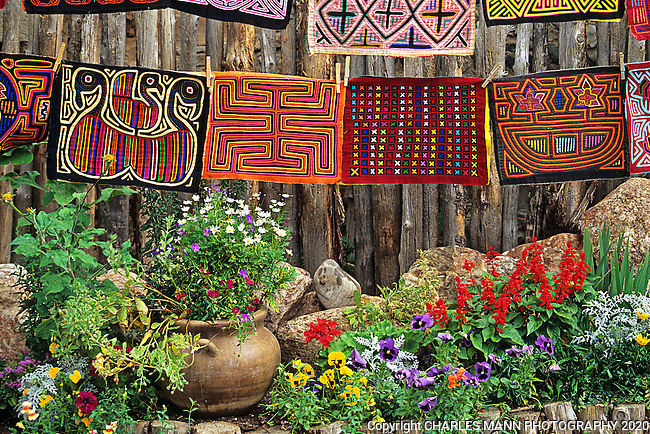 Colorful molas from southern Mexico are accented with some red salvias and other bedding plants in an exotic garden scene on Canyon Road in Santa Fe.