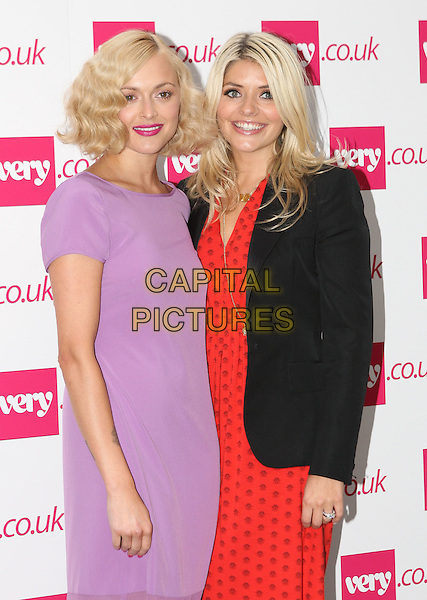 Fearne Cotton and Holly Willoughby.The Very.co.uk Fashion Preview for Spring and Summer 2012, Mercer Studios, London, England..September 20th, 2011.LFW half length purple dress blazer jacket black orange dress print  .CAP/ROS.©Steve Ross/Capital Pictures