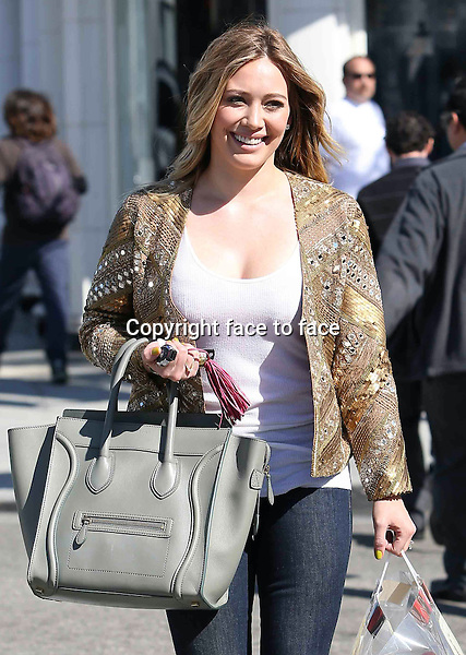 Cupcake day! Hilary Duff looked casually glamorous in her gold beaded blazer jacket while picking up a huge bag full of cupcakes at Crumbs Cupcakes in Beverly Hills today. Hilary also carried a cool gray Celine bag. Los Angeles, California on February 12, 2013...Credit: Vida/face to face