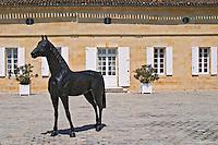 The Chateau La Couspaude courtyard with the black statue of a horse Saint Emilion Bordeaux Gironde Aquitaine France