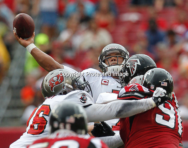 Tampa Bay Buccaneers quarterback Josh Freeman (5) tries to pass over the Atlanta Falcon blitz.  The Buccaneers defeated the Falcons 16-13 in an NFL football game Sunday, Sept. 25, 2011 in Tampa, Fla. (AP Photo/Margaret Bowles)