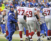 Landover, MD - November 30, 2008 -- New York Giants head coach Tom Coughlin has a pat on the fanny for offensive guard Kevin Boothe (77) as the offense leaves the field after a fouthe quarter series against the Washington Redskins at FedEx Field in Landover, Maryland on Sunday, November 30, 2008.  Also pictured are offensive guard Rich Seubert (69) and offensive tackle Kareem McKenzie (67).  The Giants won the game 23 - 7..Credit: Ron Sachs / CNP.(RESTRICTION: No New York Metro or other Newspapers within a 75 mile radius of New York City)