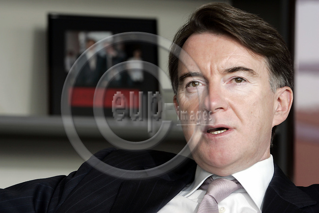 BRUSSELS - BELGIUM - 20 APRIL 2006 -- Peter MANDELSON, EU-Commissioner for Trade, during an interview in his office. In the background a photograph of Mr. Mandelson with Bo Xilai the Chinese Trade Representative. --PHOTO: JUHA ROININEN / EUP-IMAGES.-- TA --